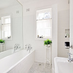 bathroom-with-mirror-over-bath-white